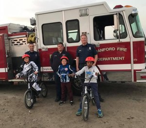 This photo from 2017 shows Hanford firefighters at the local BMX track after donating helmets to kids. The Hanford Fire Department will be holding its first free