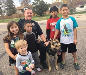 "Fort Collins' community policing officers build trust by developing one-on-one relationships with citizens through programs such as ""Shop with a Cop"" and ""ride-alongs."" (Photo/Fort Collins Police Services)"