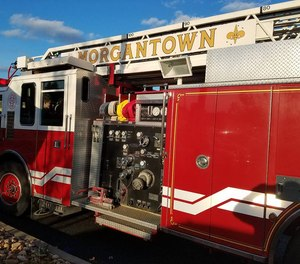 The city of Morgantown has filed a lawsuit to stop the fire civil service commission from holding a disciplinary hearing on a change that lowered 47 firefighters' pay by about $2,000.