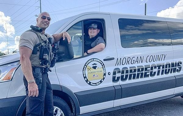 Lt. Eric Fields poses with a Morgan County corrections officer.