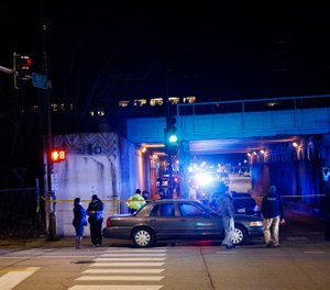 Police investigate the scene where two officers were killed after they were struck by a South Shore train near 103rd Street and Dauphin Avenue on Monday, Dec. 17, 2018, in Chicago. (Armando L. Sanchez/Chicago Tribune via AP)