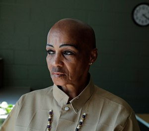 Cheryl Lidel poses for a photo in the Washington Correctional Center in Shelton, Wash. (AP Photo/Ted S. Warren)
