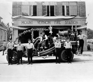 This photo shows the Mount Vernon Fire Department station and its first motorized apparatus in 1921. The department will be ending its volunteer program after nearly 130 years due to difficulty recruiting volunteers. (Photo/Mount Vernon Fire Department Facebook)