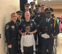 Fla. officers attend boy's graduation in place of fallen LEO father