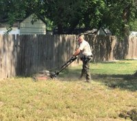 Kan. officer finishes lawn mowing job for woman
