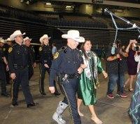 Officers escort fallen LEO's daughter to her graduation