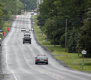 Law enforcement officers stand along Route 374 as the search for prison escapees David Sweat and Richard Matt continues (AP Image)