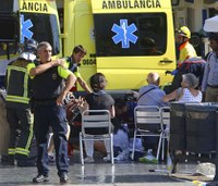 Attacker drives van into Barcelona crowd; 13 dead, 50 hurt