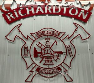 A Richardton firefighter was injured in a rollover crash battling a grass fire on Monday.