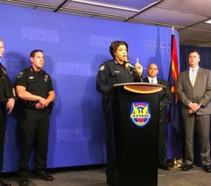 Phoenix Police Chief Jeri Williams speaks at a news conference about the linking of nine homicides to a convicted felon on Thursday, Jan. 18, 2018, in Phoenix, Ariz. (AP Photo/Terry Tang)