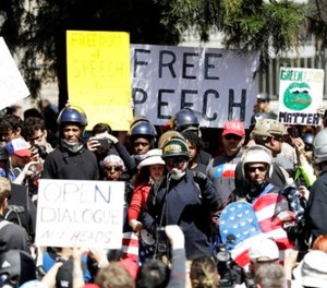A crowd gathers around speakers during a rally for free speech Thursday, April 27, 2017, in Berkeley, Calif. (AP Photo/Marcio Jose Sanchez)