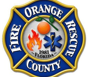 Officials say an Orange County firefighter was held at gunpoint by a senior citizen while performing a wellness check on Thursday.