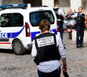French Police work on the scene where French soldiers were hit and injured by a vehicle in the western Paris suburb of Levallois-Perret near Paris, France, Wednesday, Aug. 9, 2017. (AP Photo/Kamil Zihnioglu)