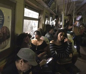 The New York Police Department says a minor derailment in Harlem caused a power outage that led to evacuations along the subway line. (Jackie Faherty via AP)