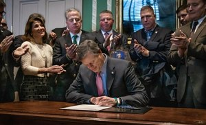 Gov. Charlie Baker signed Senate Bill 2633, which requires departments to have crisis intervention services to prevent PTSD in first responders who are dealing with psychological trauma.