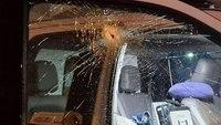 Flying metal bolt smashes window of FDNY ambulance