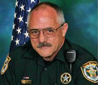 Slain Fla. deputy was trying to earn money for family trip