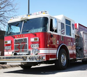 A Sedgwick County firefighter was injured after falling through ice while attempting to rescue a dog on Wednesday.