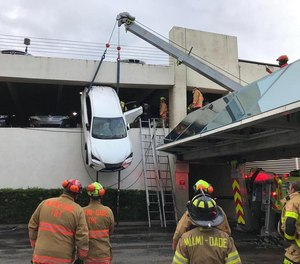 Miami-Dade Fire rescue crews jumped into action Thursday to rescue a driver from an SUV that was left dangling from a Miami Springs parking garage.