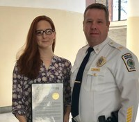 911 dispatcher honored for call about dog biting baby