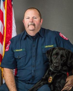 Sheldon, an arson dog at the Saginaw Fire Department, with his handler, Battalion Chief John Tadlock.