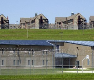 Maximum security housing units at the new Jefferson City Correctional Center sit below dormitory-style housing at a the minimum security Algoa Correctional Center in Jefferson City, Mo. (AP Photo/Kelley McCall)