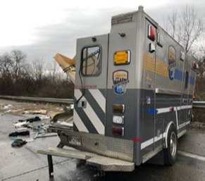 A concrete pumping truck crashed into an ambulance while an EMS crew was pulled over trying to calm a patient, according to officials.