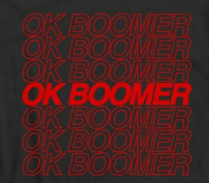 An OK boomer T-shirt designed by Grizzly Designs shows a common graphic associated with the meme.