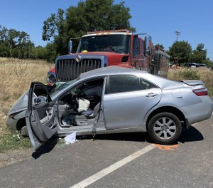 A CAL FIRE apparatus collided with a sedan Tuesday morning while responding to a fire call. A civilian motorist sustained major injuries in the crash, officials said. (Photo/California Highway Patrol)