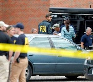 Law enforcement officials investigate an explosion at the Dar Al-Farooq Islamic Center in Bloomington, Minn., on Saturday, Aug. 5, 2017. (David Joles/Star Tribune via AP)