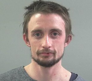 Mitchell Bryce May, 29, was charged in the theft of an ambulance last week after being arrested in an unrelated case. Police say May was in possession of controlled substances and fired a Taser at officers while being arrested. One of the officers recognized May as the suspected ambulance thief caught on video.