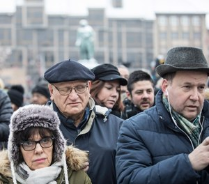 Residents react during a gathering in a central square of the eastern French city of Strasbourg, Sunday Dec.16, 2018 to pay homage to the victims of a gunman who killed five people and wounded a dozen more