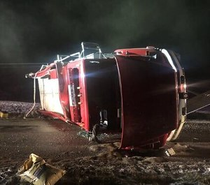 A Napoleon Volunteer Fire Department firefighter was injured in a rollover tanker crash on Tuesday. The firefighter said he was en route to a fire when his vision was obscured by the lights from another fire department's tanker.