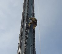 Ga. firefighters rescue injured worker dangling from cell tower