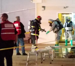 The fire extended into an adjoining lab, prompting officials to call in a hazmat decontamination unit in case firefighters and employees in the building had been exposed to potentially harmful chemicals.