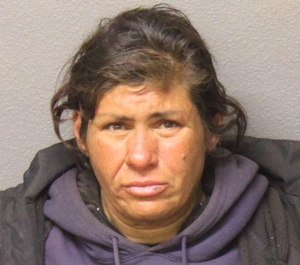 Teresa Ortiz, 45, is accused of setting the fire at a restaurant that injured a firefighter on Wednesday.