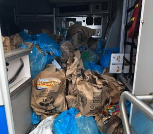 Some Penn Hills EMS staff put their ambulances to unique use by loading them up with food collected as part of the annual Stamp Out Hunger drive. (Photo/Penn Hills Paramedics IAFF Local 5167)
