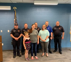 Kylee Shepherd, 7, called 911 and calmly listened and followed the dispatcher's instructions to help her mom through a seizure while she waited for paramedics to arrive. (Photo/Normal Fire Department)
