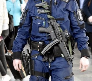 This is a April 13, 2017 file photo of a Finnish police officer carrying a MP5 submachine gun patrols at the Helsinki-Vantaa airport in Vantaa Finland . Finnish police officers will soon have MP5 submachine guns in addition to their normal equipment. (Jussi Nukari/Lehtikuva, File via AP)