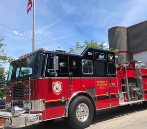 A Passaic fire apparatus collided with a minivan at an intersection on Sunday. Three firefighters were injured in the crash.