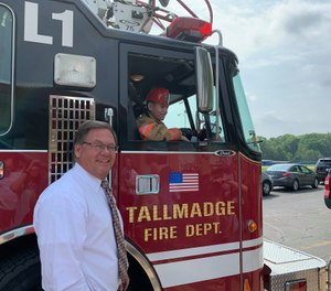 Make-A-Wish volunteers joined Tallmadge Mayor David Kline and city firefighters at the assembly to make the surprise announcement that both his wishes were coming true, much to the delight of Ian and his family. (Photo/Tallmadge Fire Department)