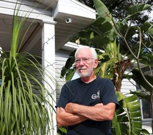 Patrick Holladay poses for a portrait in front of his Southeast Seminole Heights home on Monday, Dec. 18, 2017, in Tampa, Fla. (Alessandra Da Pra/Tampa Bay Times via AP)