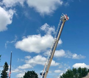 The Waterville Fire Department honored Potter by raising a flag from a ladder on one of the engines.