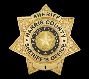 Harris County Sheriff's Office officials say a suspected drunk driver crashed into a fire apparatus twice while attempting to strike a deputy who was directing traffic at a crash scene.
