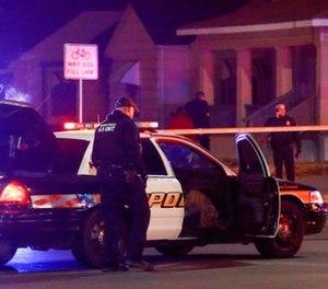 Wichita police investigate a call near the corner of McCormick and Seneca in Wichita, Kan., Thursday, Dec. 28. (Fernando Salazar /The Wichita Eagle via AP)