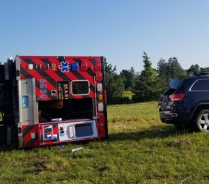 A car crossed the centerline and struck the ambulance head-on causing the emergency vehicle to veer into the eastbound lane, where it hit a Jeep head-on before coming to rest on its driver's side. (Photo/Falmouth Police Department)