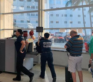 First responders go through security check point before entering the cruise ship on the way to the Bahamas. (Photo/Bahamas Paradise Cruise Line)