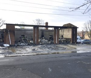Authorities say a fast-moving fire gutted an ambulance squad's building in New Jersey, destroying five ambulances and causing at least $2 million in damage overall. (Photo/AP)
