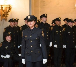 Kristen Hyman is sworn in during a June 8, 2017, ceremony for 27 new officers at the William J. Brennan Courthouse in Jersey City, N.J.