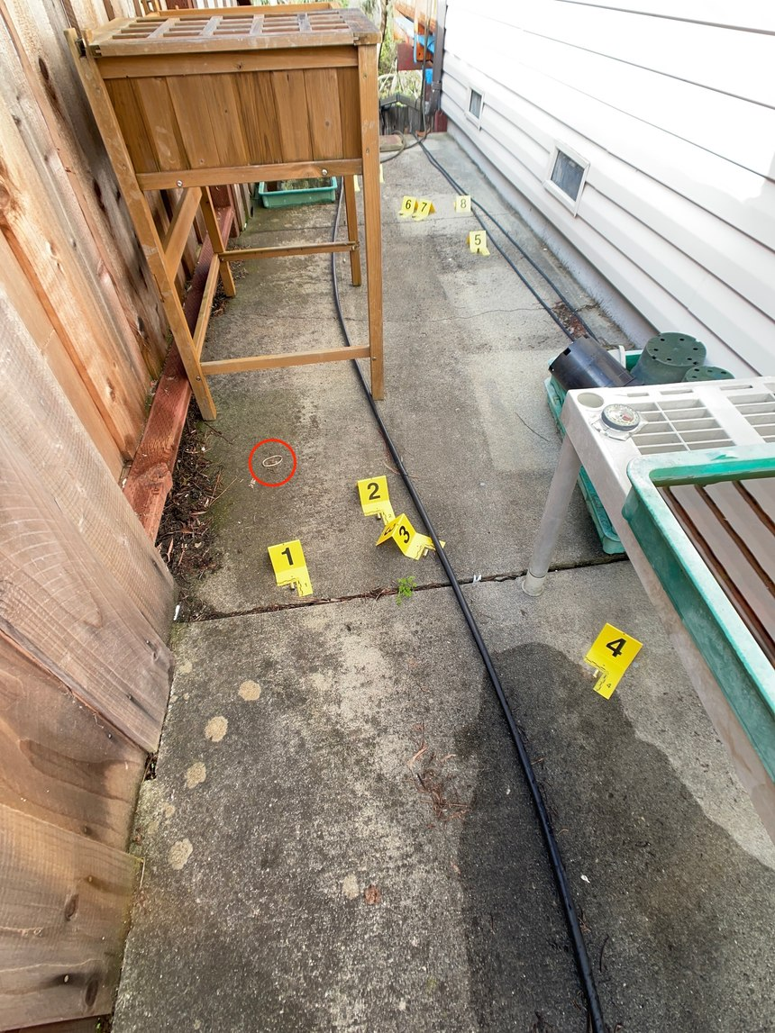 Figure 7:This image shows a medium view with evidence markers placed. Should that rubber band have an evidence marker? When in doubt, yes and this photo shows an error on the photographer's part which may or may not be significant.